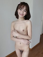 19 year old skinny Thai shemale with small tits gets a facial