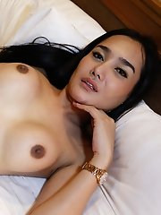 Busty Thai ladyboy takes white cock up her ass