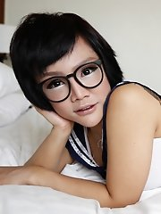 Cute 25 year Thai ladyboy in glasses gets facial from white cock